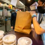 restaurant employee adapts to bagging togo orders from online ordering third party delivery